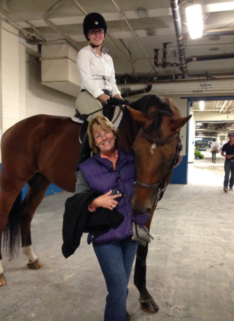 Georgie & Easy, with their trainer. Photo Courtesy of Georgie Hammond.